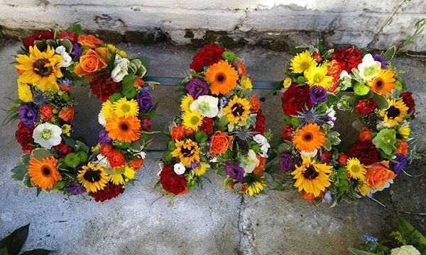 A multicoloured DAD funeral lettering, to add a little brightness to a gloomy occasion.#dad #daisyjanes #funeralflowers #florists #sympathy #sympathyflowers #funeraltribute #funeralletters #multicoloured #bright #floristsofinstagram #finalfarewell #roses #sunflower #gerbera #carnations #burnham #buckinghamshire