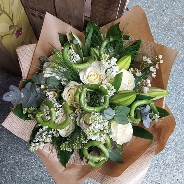 Pure and simple bouqet.#handtied #handtiedbouquet #pureandsimple #whiteroses #luckybamboo #syringa #lilac #gift #bouquet #daisyjanes #florists #roses #eucalyptus #waxflower #kraftpaper #lily #whitelilies #sympathyflowers #thinkingofyou #gift #burnham #buckinghamshire